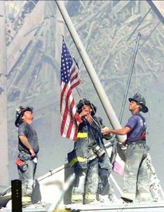 This picture shows that even through hard times that the United States will stay strong and show their pride by raising their flag through all of the sadness that was happening at the time.