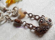 Collana tricottin, cerchi all'uncinetto e perle  di CREATIVISSIME su DaWanda.com