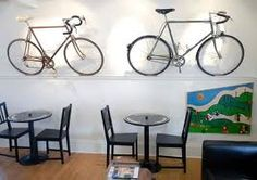 Domestique Cafe Shop Ideas, Cycling, Chandelier, Ceiling Lights, Coffee, Lighting, Drinks, Home Decor, Kaffee