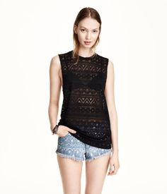 H&M Tank Top $17.95 DESCRIPTION Tank top in jersey with a burnout pattern. DETAILS 86% rayon, 13% polyester, 1% spandex