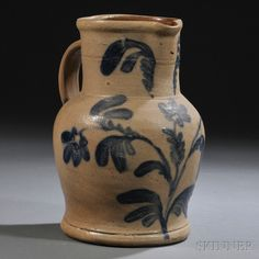 Sold for: $ 2,460 Cobalt-decorated Stoneware Pitcher, probably Pennsylvania, late 19th century, large baluster-form pitcher with wide neck, the front ornamented with cobalt leaves flanking the spout above a flowering plant, with cobalt-daubed handle terminals, ht. 10 7/8 in.