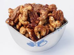 Sweet-and-Spicy Pecans... The secret to this addictive snack mix's crunchy exterior? Coat the nuts in egg whites flavored with sugar, cinnamon, cayenne pepper and cumin before baking