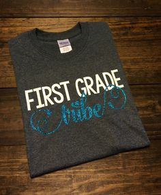 This teacher tribe t-shirt is perfect for your whole team! Great to wear on jeans day or any day! The teacher tribe design can be done for any grade or subject. Tribe will be in glitter unless you state otherwise. Also, if there are no additional color requests left at checkout, you will be sent the colors in the first example pic.  This design is done on a soft, comfortable regular unisex fit short sleeve t-shirt. If you do not see a color listed that you are looking for, please send me a…
