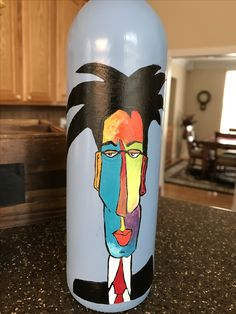 Crazy guy painted on a wine bottle.