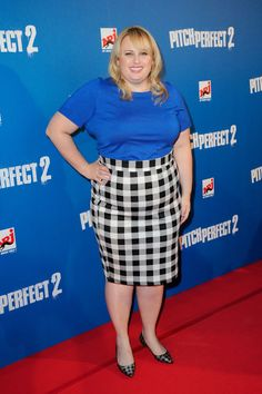 She pairs a royal blue top with a spring-y gingham pencil skirt at the Paris premiere.