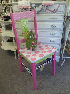 I love this chair... I don't know if I would put it on my porch or use it at school, but I want to paint one like this.
