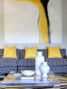 "Hello, yellow! This bright, happy color can't help but bring a smile to your face. Artwork and accent pillows are two simple ways to let the ""sunshine"" in to your room. To make the color pop even more, pair it with a soft neutral, such as gray or white."