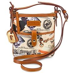 I have this purse, and LOVE it! Disneyland Anniversary Crossbody Bag by Dooney and Bourke Disney Tote Bags, Disney Handbags, Disney Purse, Purses And Handbags, Fashion Handbags, Dooney And Bourke Disney, Disney Dooney, Dooney Bourke, Disney Merchandise
