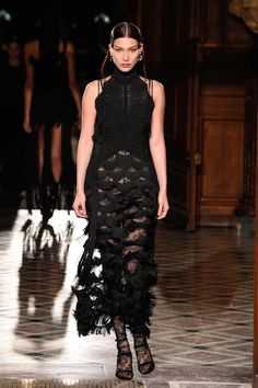 Riccardo Tisci combined his menswear and Couture shows to feature both men's separates and intricate dresse...