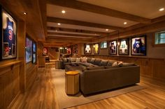 70 Home Basement Design Ideas For Men – Masculine Retreats Sports Theme Home Basement With Brown Hardwood Flooring - Heimkino Systemdienste Small Basements, Home Theater Design, House, Man Cave Home Bar, Home, Basement Decor, Family Room Design, Basement Remodeling, House Interior