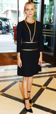 """SEPTEMBER 7, 2014  Diane Kruger opted for a classic LBD for the re-opening of Berlin's """"Boulevard Der Stars,"""" selecting a long-sleeve Prada design with gold accents for the occasion. A gold timepiece and ankle-strap pumps completed her look."""