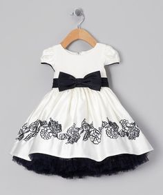 Take a look at this Ivory & Navy Bow Embroidered Dress - Infant, Toddler…