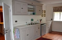 The French Flair Kitchen in French Linen (grey). Without the twirls. And with a continuous Caesar Stone top.