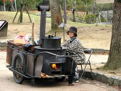 Yaki Imo (roasted sweet potato) vendor in Japan- among the many fabulous street foods which the Japanese do so well.     http://www.smosh.com/smosh-pit/articles/8-wild-japanese-street-foods