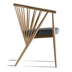 This striking ash easy chair, coined GINNY, is designed by Centro Ricerche MAAM. Available in multiple colors.