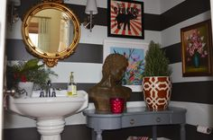 Awesome, bold bathroom and great tutorial on how to paint stripes without bleeding paint.