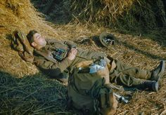 A British lieutenant sleeps in the hay during fighting in Italy, 1944.