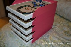 Jewelry organizer trays, slid into stacking letter trays - kind of like this visual.