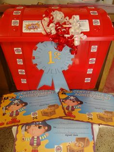 The red plastic tresaure chest I found at Walmart.  The Pirate certificates I found at Dollar Tree and embelished them with pirate and box tops stickers.  Each Pre-School winner received one.