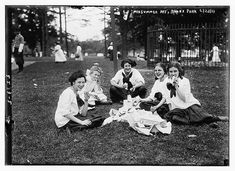 Midsummer Day, Bronx Park. Photograph shows girls from the Washington Irving High Schools, New York City, having a picnic at the Midsummer Day Festival which was held at Pelham Bay Park in the Bronx on June 23, 1911.