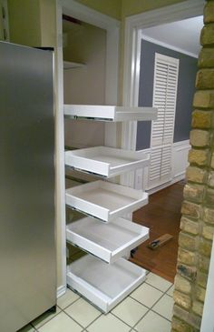 Pull out shelves for cupboards and pantry - great website with all kinds of DIY projects --- Great Idea for Mom's pantry. She's always wanted pull out shelves! Pull Out Pantry Shelves, Sliding Shelves, Pantry Shelving, Sliding Drawers, Wire Shelves, Pantry Storage, Diy Storage, Malm Drawers, Cabinet Drawers