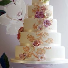Pretty Gold Piping  Flowers Tiered Cake Photo