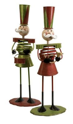 """Whimsical metal nutcracker inspired characters are painted in red and green to deck the holidays with joy. Get this pair to add to your collection! Material: 100% Iron. 36""""h x 13.25""""w x 9.25""""."""