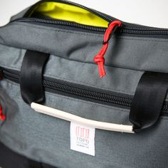 #briefcase, men's briefcase, The Mountain Briefcase is a unique bag that allows you to carry your gear in a traditional two handle briefcase style, as a backpack with stoppable straps, or over the shoulder with a removable shoulder strap.
