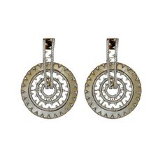 These earrings by Anmol Jewellers are crafted in 18 K gold and set with Mother-of-Pearls and round brilliant diamonds.