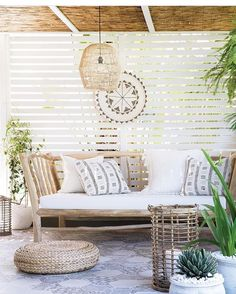a welcoming tropical patio with a rustic wooden bench with pillows, a wicker lamp, a woven ottoman and a rattan candle holder Outdoor Rooms, Outdoor Living, Outdoor Decor, Outdoor Areas, Rustic Wooden Bench, Tropical Patio, Tropical Vibes, Deco Zen, Ideas Hogar