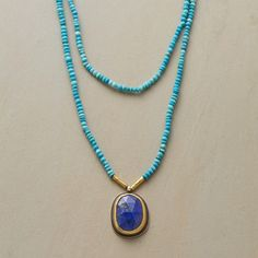 EXCEPTIONAL LAPIS NECKLACE -- In this Ananda Khalsa lapis and gold necklace, the rose-cut gemstone appears at its finest, embraced by 22kt gold and kissed with beads of the same precious metal. Handcrafted in USA. Oxidized sterling silver backing. Two strands of vibrant turquoise