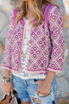 Fuchsia embellished jacket, white sheer lace tank, and distressed jean shorts make for one funky, mismatched, and incredible outfit!