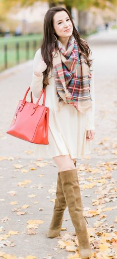 Beige cotton swing dress with tartan blanket scarf, Free People cognac OTK boots, red Ralph Lauren handbag, and Kendra Scott Sophee earrings | Casual holiday outfit idea | 10 tips for looking your best on camera |  How to look good on camera by fashion blogger Stephanie Ziajka from Diary of a Debutante