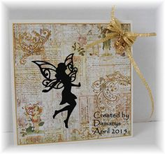 Card was made using a Spellbinder faerie die, and embellished with gold embossing, glitter, and a gold bow with a tiny unicorn charm. Background paper is from Prima Marketing.