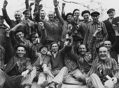 Arland Muster - Polish prisoners in Dachau Nazi concentration camp in Germany joyfully celebrating their liberation by the US Army.
