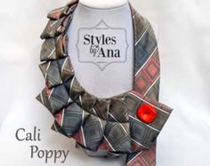 A new twist on the old tie! :) The upcycled neckties make a bold statement and add a little pizzazz! to your everyday wardrobe. Try it with the classic white Tee & jeans, any colored tank tops, collared shirts and even casual dresses. Its sure to make an impression! No two neckties are alike. The MyTie fastens with a button pin. The buttons are interchangeable for more diversity with your garment and easily adjustable around your neckline, just choose your button! If you have your own pin...