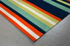 Simple stripe patterns combine with sophisticated blended colors in this Indoor/Outdoor flatweave.100% Polyester, this flat weave reversible rug is easy to care for and great for any indoor outdoor space.Soft Polyester is tightly hand woven by artisans in India with great attention paid to detail such as the serging to create this durable yet attractive Indoor Outdoor rug.