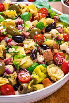 Antipasto Tortellini Pasta Salad - Host The Toast - Antipasto Tortellini Pasta Salad. This packed potluck favorite includes multiple cheeses, meats, olives, peppers, and more to create a hearty Italian-inspired summer side dish. Antipasto Salad, Appetizer Salads, Potluck Salad, Antipasto Skewers, Fruit Salad, Antipasto Platter, Italian Appetizers, Antipasta Salad Recipe, Italian Antipasto