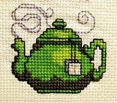Cross-stitch teapot!  Supposed to be in Donna Kooler's 555 country cross stitch patterns or another of her books...not sure which one