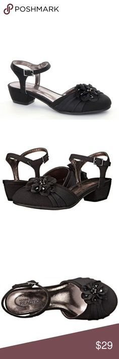 "KENNETH COLE Girls Belle Flower Girls Dress Shoes NIB! In Black This sparkly satin dress sandal will dress up any special occasion outfit.  *Round toe *Rose applique *Rhinestone detail *Ankle strap with adjustable buckle closure *Chunky heel *Approx. 1.5"" heel *Textured sole  ❌NO TRADES  I❤️Bundles ❤️REASONABLE OFFERS ONLY PLEASE❤️ Kenneth Cole Reaction Shoes Dress Shoes"