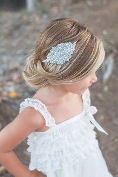 cute low bun hairstyle for girl with rhinestone headband