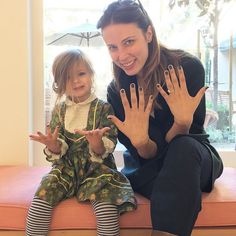 My new bestie, Alice! Got her first mani at #OJPAS - purple sparkles!! SHE IS SO CUTE. #olivemyjob Xx @gibsontuttle
