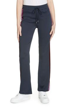 Street-chic track pants get a cool new twist in a deconstructed design with bright-striped snap vents moved to the front. Athletic Pants, Deconstruction, Sandro, Street Chic, Jeans, Pajama Pants, Nordstrom, Sweatpants, Track