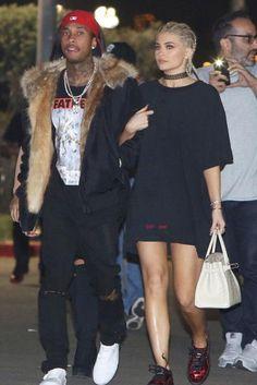 Kylie Jenner wearing Hermes Crocodile Birkin Bag, Off-White Logo Print T-Shirt and Puma Basket Platform Metallic Sneakers in Red