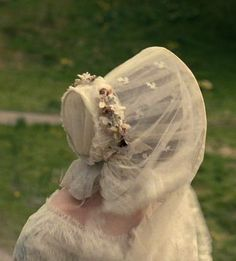 Back view of bonnet, with veil down. The foundation is a wire frame, covered with tulle. - Mia Wasikowska in the title role of Jane Eyre (2011).