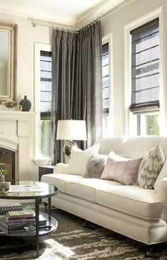 Curtains to ceiling with window shades. Design by Kelly Deck, photograph by Barry Calhoun, via The Globe and Mail