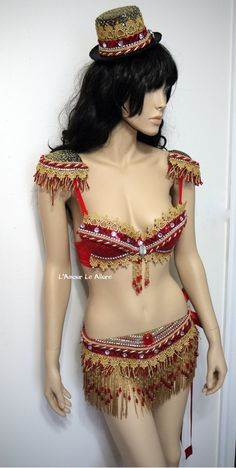 http://lamourleallure.storenvy.com/collections/1382639-circus-ring-leader-animal/products/16456500-red-and-gold-ring-leader-bra-cosplay-dance-costume-rave-bra-rave-wear-hallow
