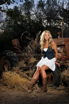Country Girl, Tractor, denim and boots, portrait