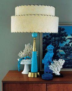 An aqua blue lamp looks so happy in this vignette!