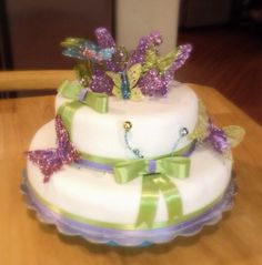 The baby shower cake I made for Autumn Jewel. Theme is butterflies. Pink blue purple and green;)